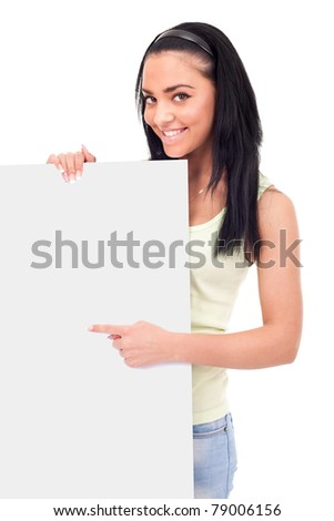 teenager pointing at a blank board, smiling cute girl,  isolated on white background - stock photo