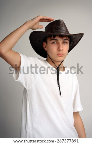 Teenager Portrait in the Studio in the Stetson Hat - stock photo