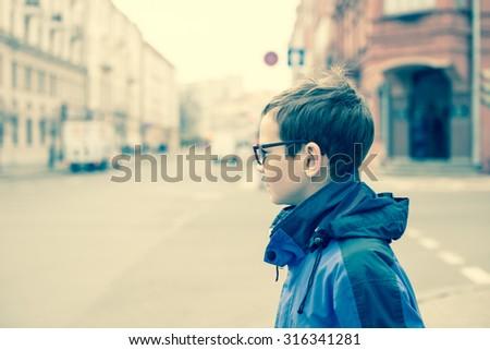 Teenager Portrait on the City Street/toned photo - stock photo