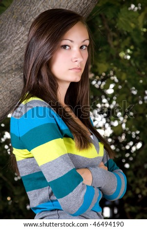 Teenager Posing with her arms crossed - stock photo