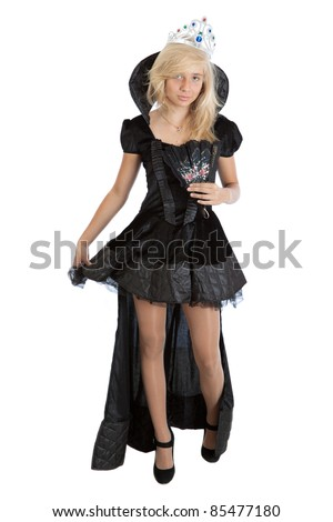 teenager princess girl wearing in long black velvet dress and crown