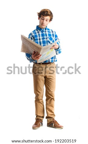 teenager reading a newspaper - stock photo