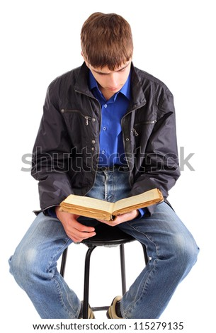 teenager reads old book isolated on the white background - stock photo