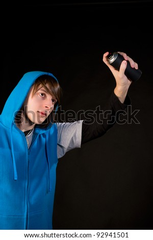 Teenager ready to start using a can of spray - stock photo