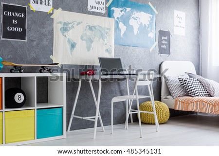 Teenager room with a bed, working area and commode with colourful boxes