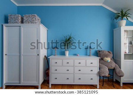 Teenager room with furniture and toys - stock photo
