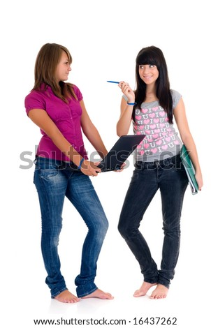 Teenager schoolgirls with computer and books on white background - stock photo