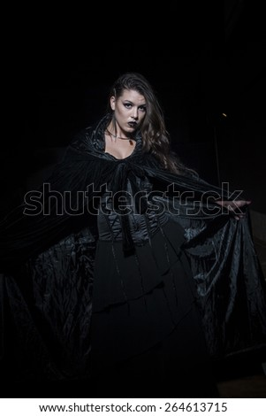 Teenager, Sensual young girl dressed in black coat with gothic style - stock photo