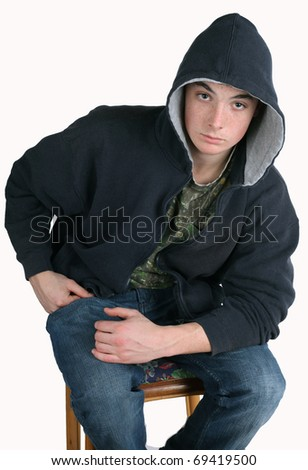 Teenager Sitting on Stool Wearing Hoody