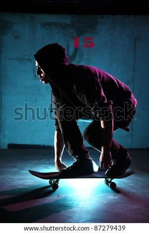 teenager skateboarding at night - stock photo