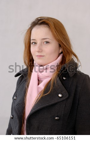 Teenager smiling girl portrait over uniform background - stock photo