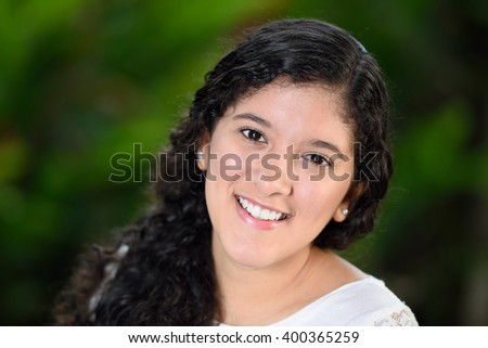 teenager smiling on a green background