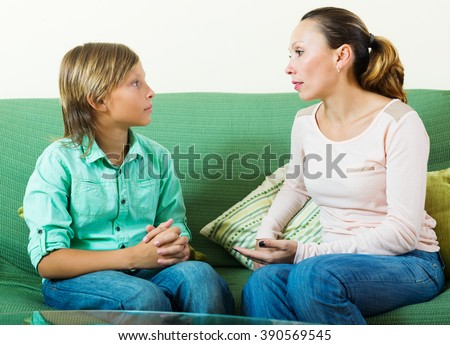 teenager son and  mother having serious talking  - stock photo