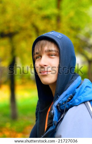 teenager stand in the park