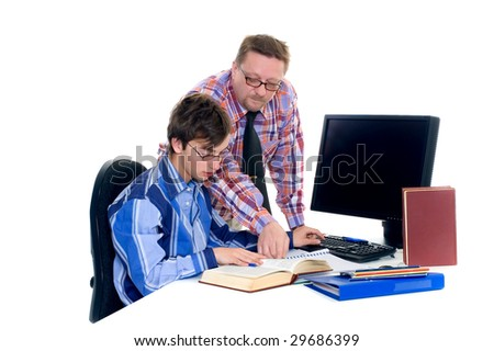 Teenager student doing homework with computer and books on desk, helping father, white background - stock photo