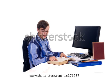 Teenager student doing homework with computer and books on desk, white background