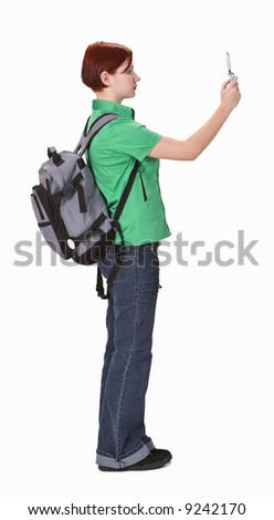Teenager taking photos using a mobile phone camera-profile. - stock photo