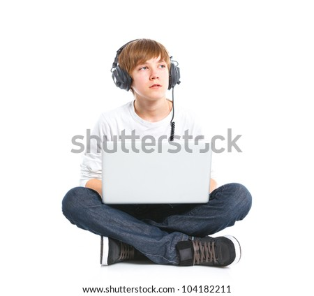 Teenager using a laptop. Isolated on white background - stock photo