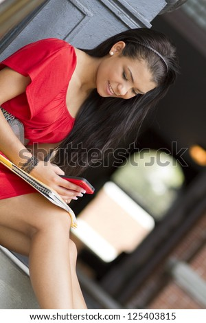 Teenager using a mobile phone - stock photo