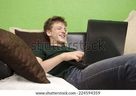 Teenager using laptop - stock photo