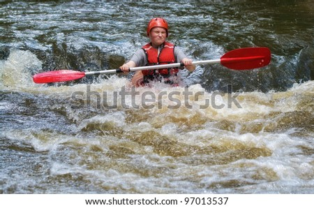 teenager white water kayaking