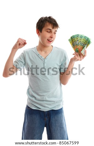 Teenager with a handful of cash banknotes and making a fist