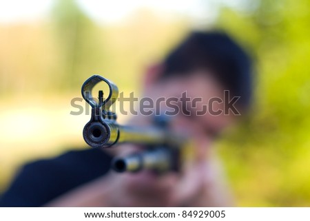 teenager with a pneumatic weapon - stock photo