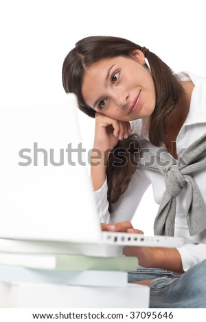 Teenager with books and laptop on white background