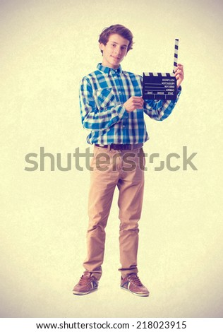 teenager with clapperboard. - stock photo