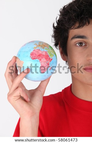 Teenager with globe