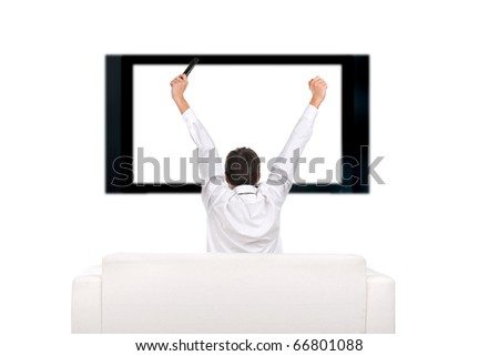 teenager with hands up watching tv-set - stock photo