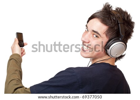 Teenager with headphone and mp3 player enjoys music. Isolated on white background. - stock photo