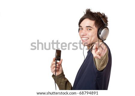 Teenager with headphones and mp3 player points with finger. Isolated on white background.
