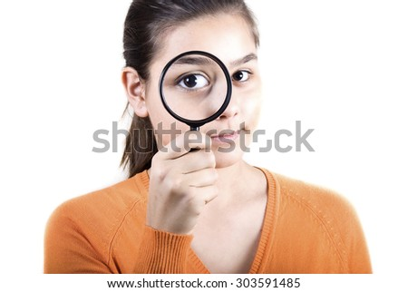 Teenager with magnifying glass