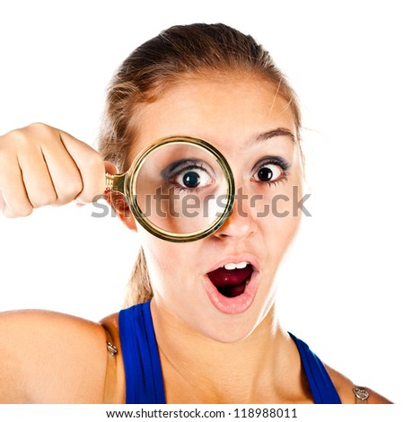 teenager with magnifying glass isolated on a white background - stock photo