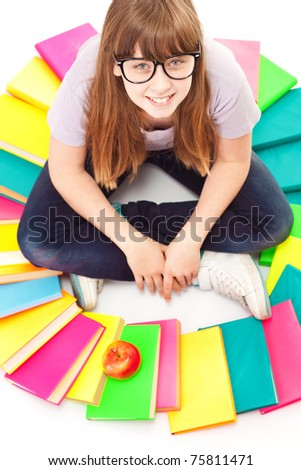 teenager with pile of books and apple, close up, isolated on white - stock photo