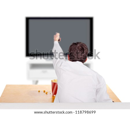 Teenager with Remote control sitting on the Sofa and Watching Tv-set - stock photo
