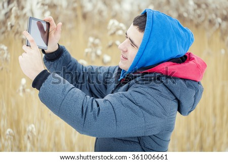 Teenager with tablet PC at outdoor