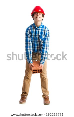teenager with work helmet holding a brick. isolated - stock photo