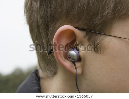 teenagerear with canalphones -  risk of hearing-loss - stock photo