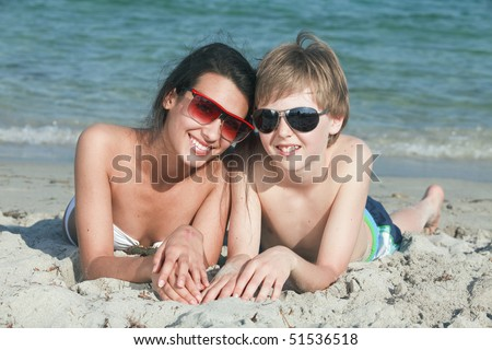 Teenagers at the Beach - stock photo