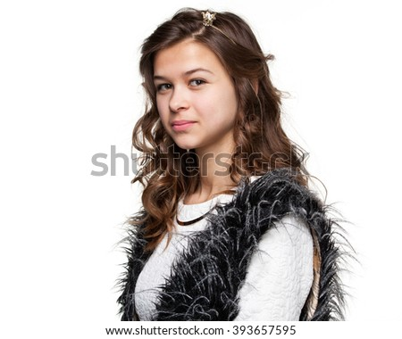 Teenagers. Close up portrait of a young smiling girl with long hair in a light shirt and fuzzy vest, profile view, isolated on white background - stock photo