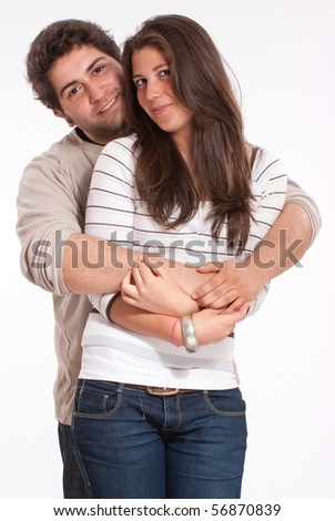 Teenagers couple in a tender embrace isolated on white - stock photo