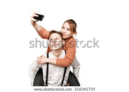 teenagers couple making selfie by smartphone - stock photo