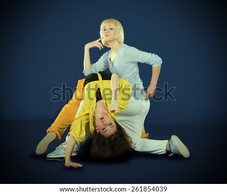 Teenagers dancing breakdance in action - stock photo