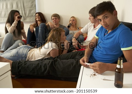 Teenagers drinking and smoking - stock photo
