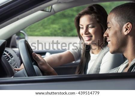 Teenagers driving car - stock photo