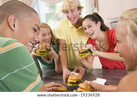 Teenagers Eating Burgers - stock photo
