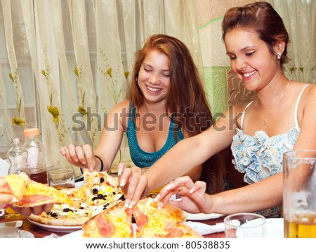 teenagers eating pizza in restaurant - stock photo