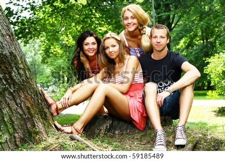 teenagers group of boys and girls in the park - stock photo